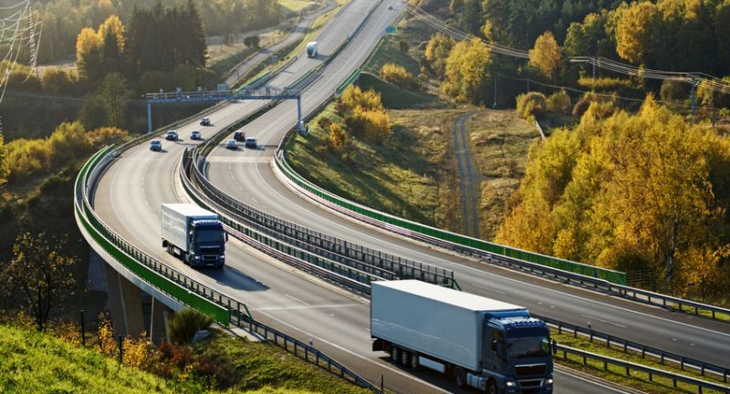 truck, trucking, lorry, trailer, car, vehicle, automobile, freight, haulage, transport, traffic, transit, transportation, logistic, cargo, delivery, conveyance, drive, ride, highway, freeway, expressway, motorway, road, infrastructure, turn, curve, bend, bridge, electronic toll gate, toll, autumn, fall, landscape, countryside, nature, top view, meadow, green, golden, orange, yellow, tree, wood, forest, deciduous, hill, slope, uphill, downhill, truck, trucking, lorry, trailer, car, vehicle, automobile, freight, haulage, transport, traffic, transit, transportation, logistic, cargo, delivery, conveyance, drive, ride, highway, freeway, expressway, motorway, road, infrastructure, turn, curve, bend, bridge, electronic toll gate, toll, autumn, fall, landscape, countryside, nature, top view, meadow, green, golden, orange, yellow, tree, wood, forest, deciduous, hill, slope, uphill, downhill